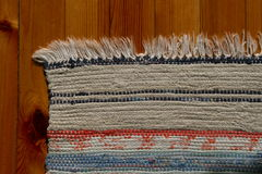 Home wowen rug. Detail of a home wowen traditional norwegian rug called fillerye Stock Photo