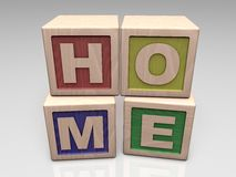 HOME written with wooden blocks Stock Photos