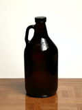 Homebrew Beer in Growler. A 64 ounce growler that contains bottle conditioned beer Royalty Free Stock Photo