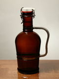 Homebrew Beer in Swing Top Growler with Handle. A 64 ounce growler that contains bottle conditioned beer Royalty Free Stock Image