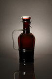Homebrew Beer in Swing Top Growler with Handle. A 64 ounce growler that contains bottle conditioned beer Stock Photo
