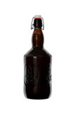 Homebrew Beer in Swing Top Growler. A 64 ounce growler that contains bottle conditioned beer Royalty Free Stock Photos