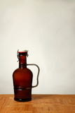 Homebrew Beer in Swing Top Growler. A 64 ounce growler that contains bottle conditioned beer Stock Photography