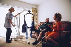 Free Homecare Workers Preparing Hoist Stock Images - 77186954