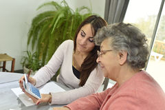 Homecaring assistant helping the elderly Royalty Free Stock Photography