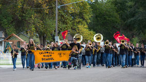 Homecoming band. CALDWELL, IDAHO/USA - SEPTEMBER 27: A Group of students start the parade playing music and carry a banner at the Caldwell High School Homecoming Stock Images