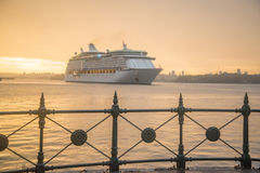 Homecoming. Cruise ship coming into Sydney Harbour with fence Royalty Free Stock Photography