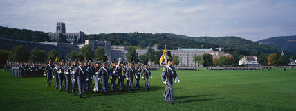 Homecoming Parade of Cadets. This is the exterior of the West Point Military Academy. Marching are the Homecoming Parade of Cadets in grey uniforms and tall hats Stock Photography