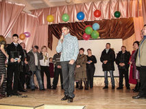 A homecoming at a rural school in Kaluga region in Russia. In Russian schools the annual tradition is held the evening reunion, when the school is visited by Royalty Free Stock Photos