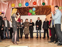 A homecoming at a rural school in Kaluga region in Russia. In Russian schools the annual tradition is held the evening reunion, when the school is visited by Royalty Free Stock Photo