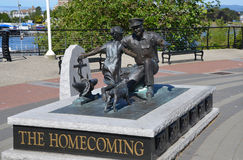 'The Homecoming'. VICTORIA BC CANADA JUNE 24 2015: 'The Homecoming' by Nathan Scott, which is a bronze figure sculpture commemorating the 100th Anniversary for Royalty Free Stock Image