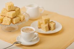 Homecooking banoffee with coffee. Banana biscuits squares. Stock Photo