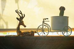 Homedecoration. Reindeer statue and bicycle statue stock image
