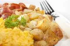 Homefries durcheinandergemischtes Ei-Frühstück stockbilder