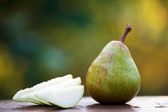 Homegrown organic pear with cut slices Stock Photos