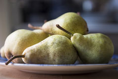 Homegrown Pears on a Plate in a Kitchen. Fresh picked Pears on a plate with soft focus background Stock Images