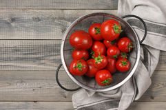 Homegrown tomatoes in colander Royalty Free Stock Images