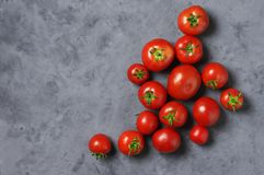 Homegrown tomatoes on grey Stock Photo