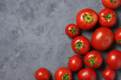 Homegrown tomatoes on grey Stock Photography