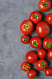 Homegrown tomatoes on grey Royalty Free Stock Images