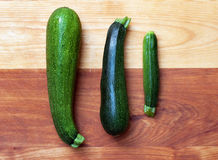 Homegrown Zucchini. Organic home-grown zucchini of various sizes and shapes Royalty Free Stock Photo