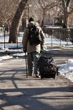 Homeless. This picture represents a homeless walking down the park in the lower east side of Manhattan, illustrating a social problem that was aggravated Stock Photo
