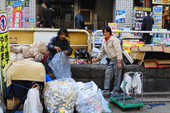 Homeless. Two homeless beggar collect aluminium cans in Tokyo, Japan Royalty Free Stock Image