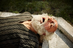 Homeless. Man with beard sleeping on the street, selective focus Stock Photo