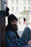HOMELESS. Close-up of homeless man sitting on the Ottawa street Stock Images