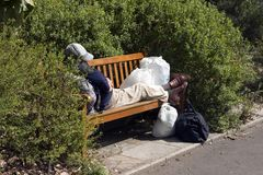 Homeless. Destitute on a park bench Royalty Free Stock Photos