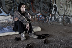 Homeless alcoholic drinking beer Royalty Free Stock Photography