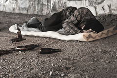 Homeless alcoholic man. Sleeping outdoors royalty free stock photos
