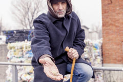 Homeless asks charity in landfill. During wintertime Stock Photography