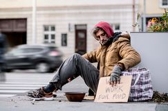 Homeless Beggar Man Sitting Outdoors In City Asking For Money Donation. Stock Photos