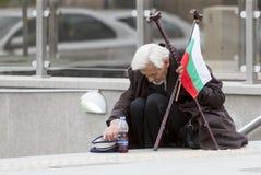 Homeless beggar for money Stock Images