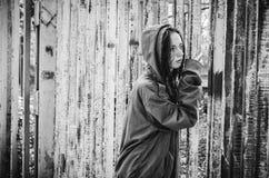 Homeless beggar stilzhizni, health, social kontsept- tired, miserable homeless hungry man standing at the iron gates stock image