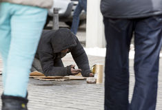 Homeless begger begging Stock Image