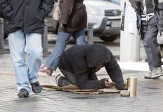Homeless begger begging Royalty Free Stock Image