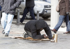 Homeless begger begging Royalty Free Stock Images