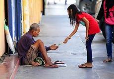 Homeless begger begging Stock Images
