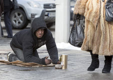 Homeless begger begging Royalty Free Stock Image