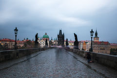 Homeless begs for money on Charles bridge, Prague Royalty Free Stock Image