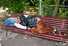 Homeless on the bench Royalty Free Stock Image