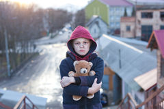 Homeless boy with bear Stock Photos