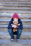 Homeless boy with bear Stock Image
