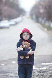 Homeless boy with bear Stock Photography