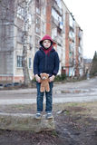 Homeless boy with bear Royalty Free Stock Images