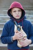 Homeless boy holding a bottle alcohol Royalty Free Stock Photography
