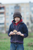 Homeless boy holding a cardboard house Royalty Free Stock Images