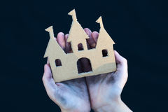Homeless boy holds a cardboard castle Royalty Free Stock Photo